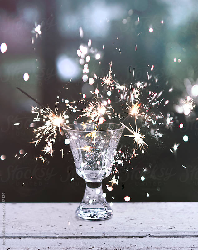 Sparklers in a transparent glass by Jovana Rikalo for Stocksy United