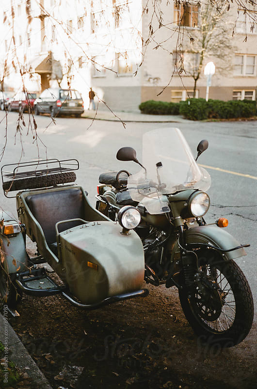A parked motorcycle and sidecar. by Benj Haisch for Stocksy United