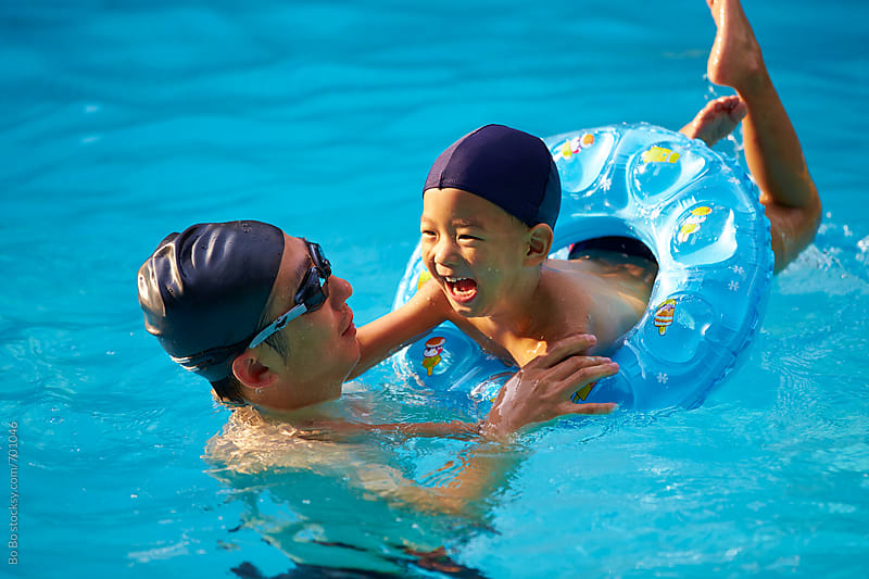 happy asian kid in swimming pool by Bo Bo for Stocksy United