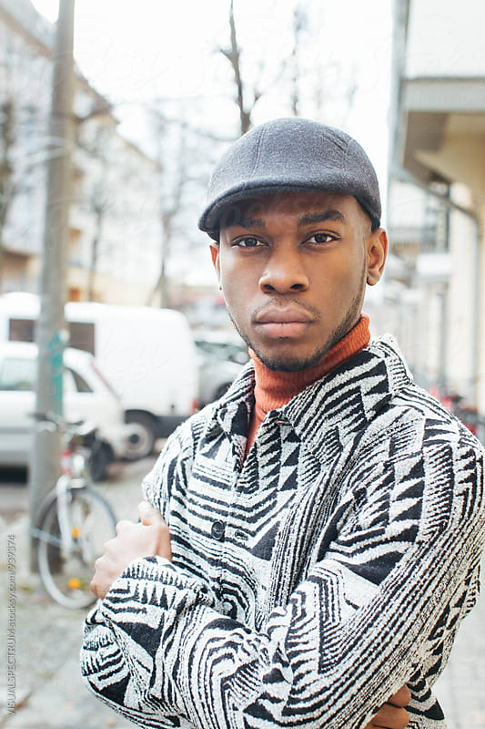 Outdoor Portrait of Tastefully-Dressed Young Black Man by Julien L. Balmer for Stocksy United