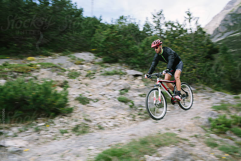 Man Riding a Mountain Bike by Davide Illini for Stocksy United