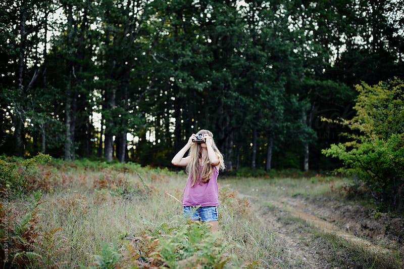 Girl with vintage camera by Svetlana Shchemeleva for Stocksy United