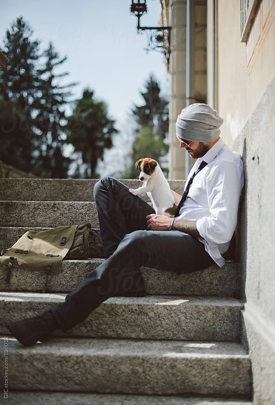 Young businessman with his puppy outdoors by GIC for Stocksy United