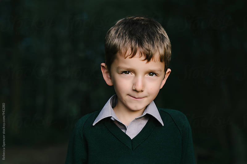 Portrait of a boy wearing green by Rebecca Spencer for Stocksy United