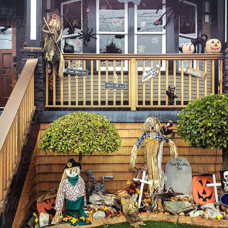 House entrance with Halloween decorations by Luca Pierro for Stocksy United