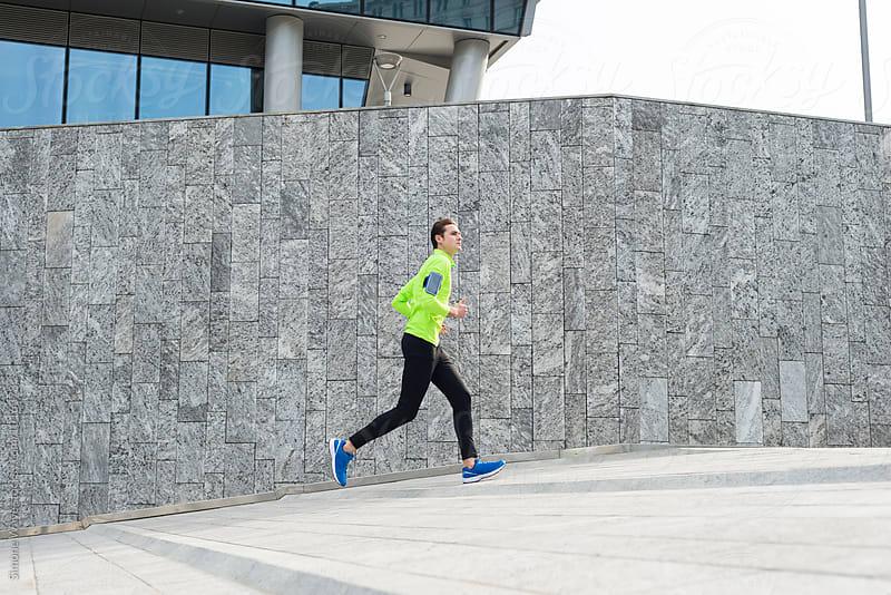 Runner training in the city by GIC for Stocksy United