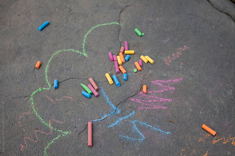 Colored Chalk on the Ground by Sari Wynne Ruff for Stocksy United
