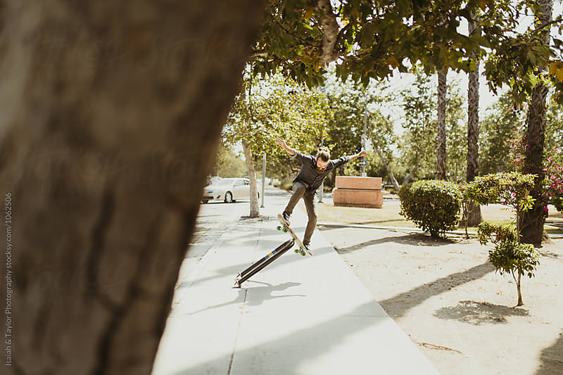 Street skateboarder by Isaiah & Taylor Photography for Stocksy United