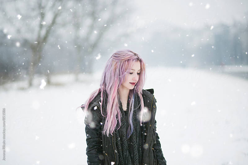 Snowy portrait of young woman with pink hair by Jovana Rikalo for Stocksy United