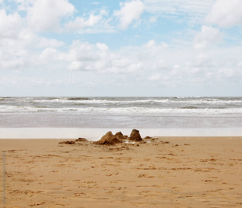 sand castle on the beach by Sonja Lekovic for Stocksy United