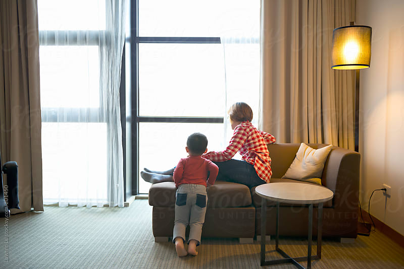 Mother and kid relaxed in room  by Lawren Lu for Stocksy United