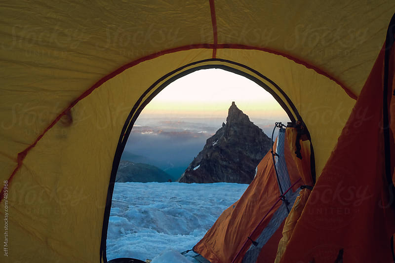 Mountain frames by tent by Jeff Marsh for Stocksy United