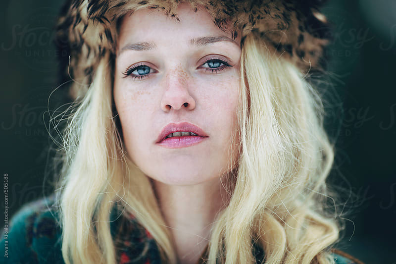 Portrait of a beautiful woman with freckles and blue eyes by Jovana Rikalo for Stocksy United