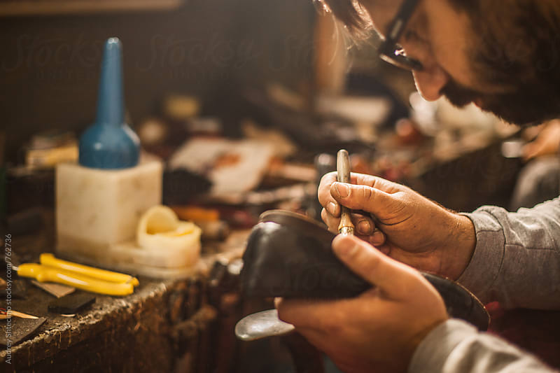 Close up/detail of shoemaker at his workshop. by Marko Milanovic for Stocksy United