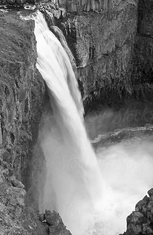 Palouse Falls black and white tumbling into gorge, Washington by Ron Mellott for Stocksy United