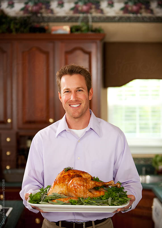 Thanksgiving: Man Holding Platter with Roast Turkey by Sean Locke for Stocksy United