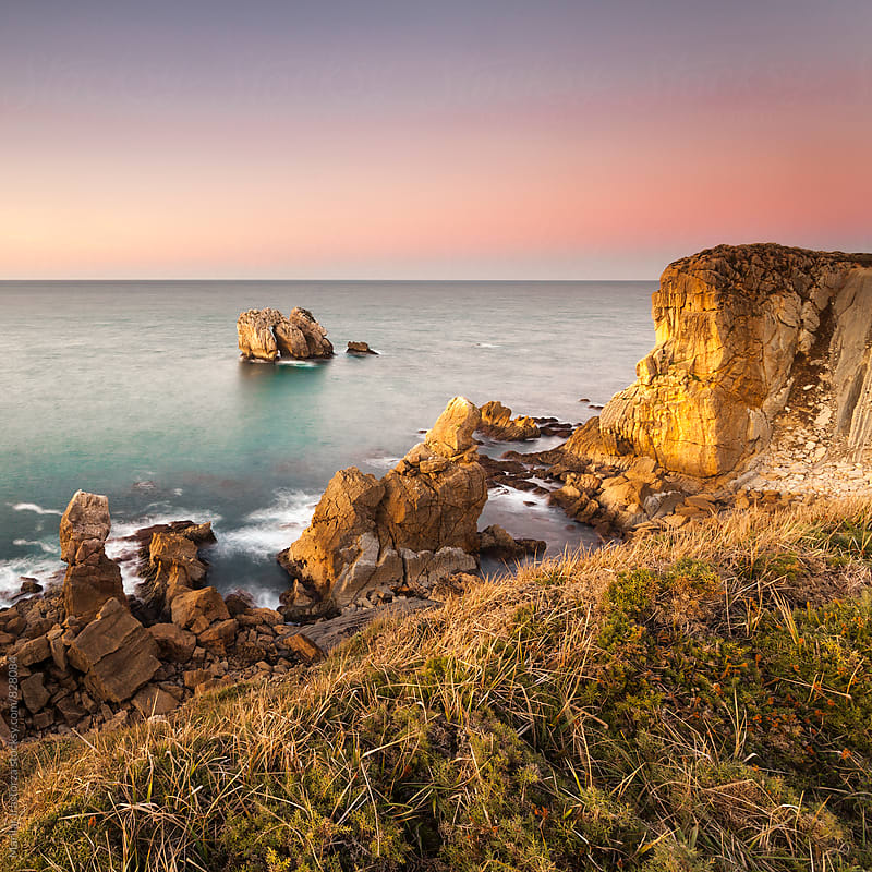 Beautiful rocky coastline at sunset by Marilar Irastorza for Stocksy United