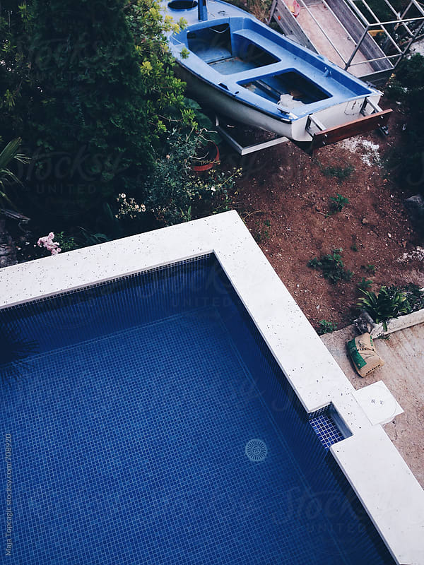 Pool from above in summer by Maja Topcagic for Stocksy United