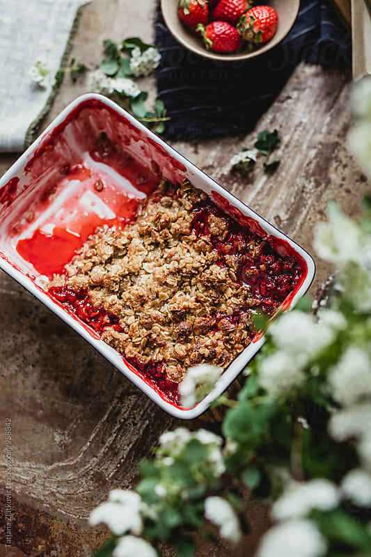 Vegan strawberry crumble on spring table by Tatjana Ristanic for Stocksy United