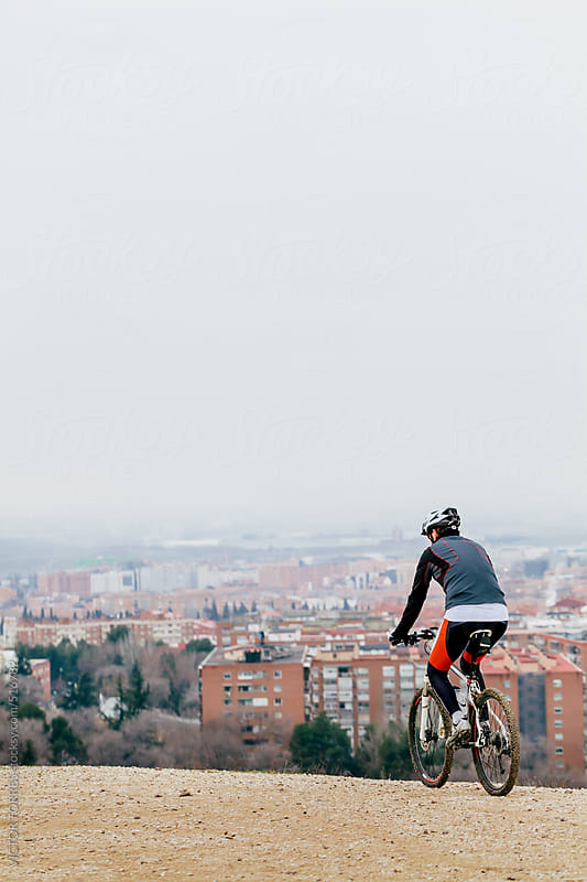Mountain Bike Rinding on a City Viewpoint by VICTOR TORRES for Stocksy United