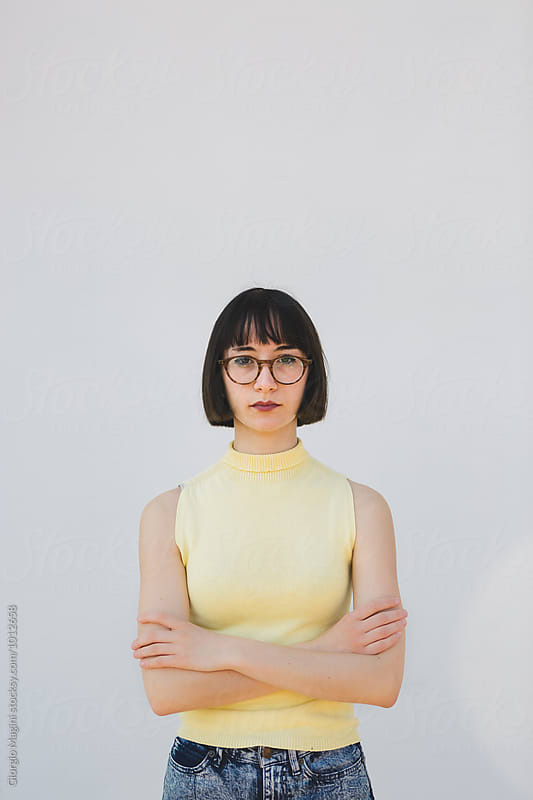 Serious Nerdy Woman On White Background by Giorgio Magini for Stocksy United