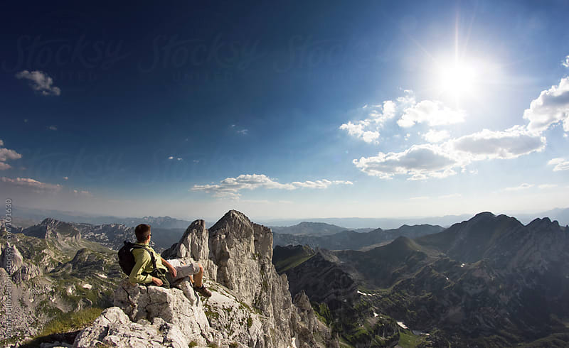 Young climber resting at the top of the mountain by Marko Milovanović for Stocksy United