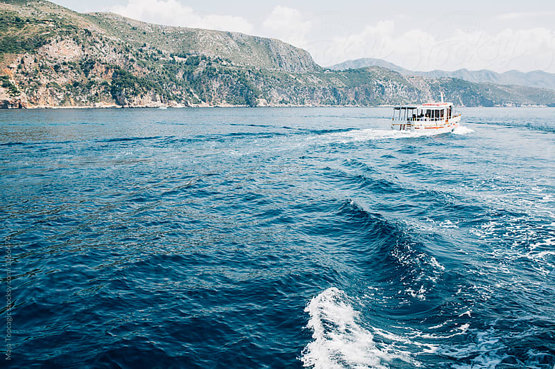 Boat sailing on the sea near Dubrovnik by Maja Topcagic for Stocksy United
