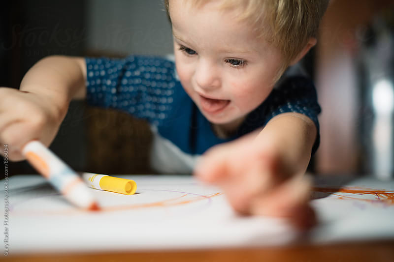 Little Boy Happily Drawing by Gary Radler Photography for Stocksy United
