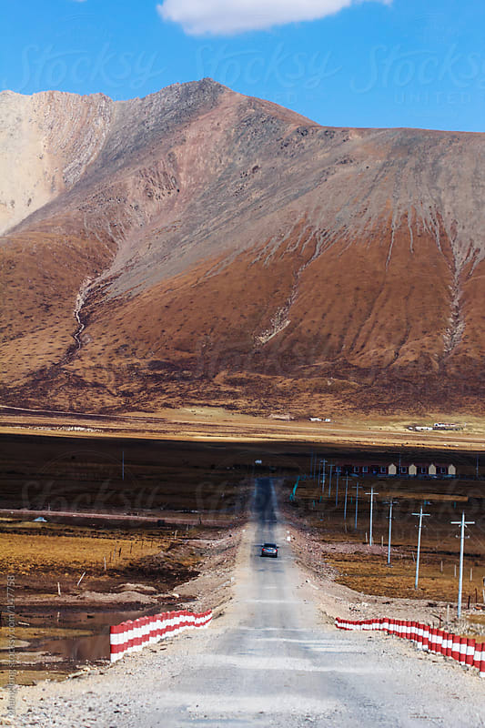 car running on the road,Qinghai by zheng long for Stocksy United