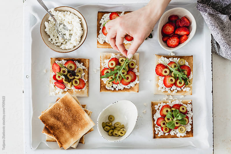 Making strawberry sandwiches by Tatjana Zlatkovic for Stocksy United