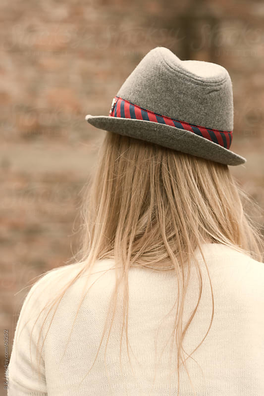 girl with a hat by B & J for Stocksy United