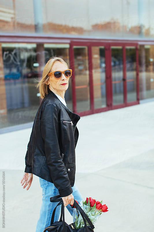 Stylish senior woman walking on the street. by BONNINSTUDIO for Stocksy United