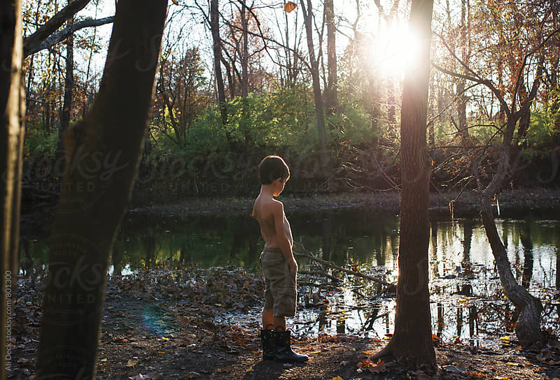 Boy by a Creek by Ali Deck for Stocksy United