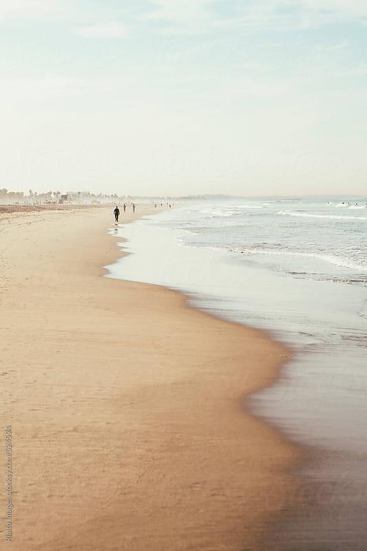 People walking along beach and Pacific Ocean, Santa Monica, CA, USA by Paul Edmondson for Stocksy United