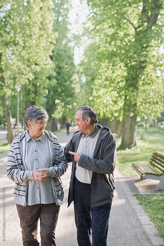 Elderly couple enjoying each other laughing outdoor by RG&B Images for Stocksy United