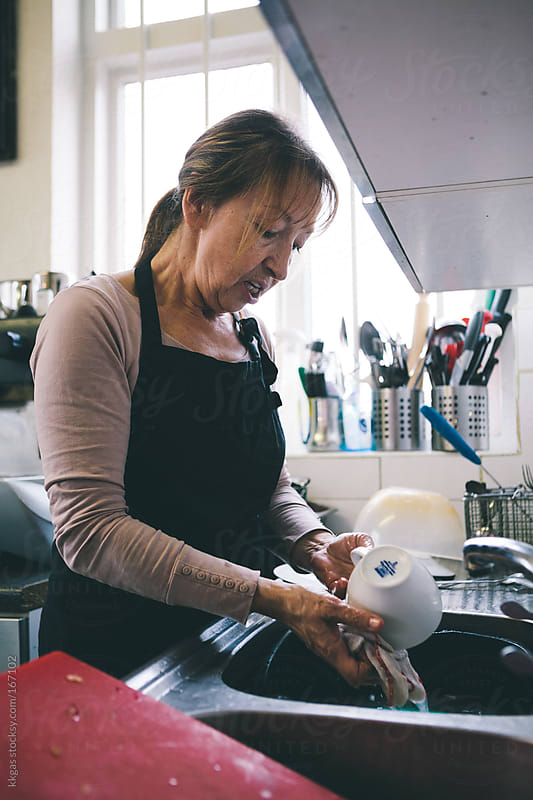 Woman at work washing dishes   by kkgas for Stocksy United