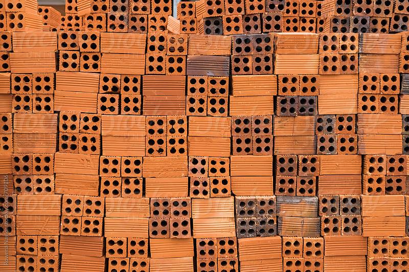 Wall of handmade bricks by Rowena Naylor for Stocksy United