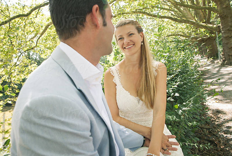 Wedding Couple Smiling at Each Other by VISUALSPECTRUM for Stocksy United
