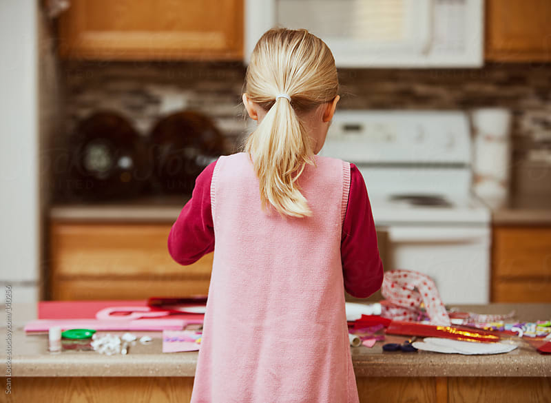 Valentine: Little Girl Working On Crafts by Sean Locke for Stocksy United