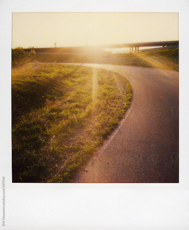 Polaroid of sun shining on an overpass by Erik Naumann for Stocksy United