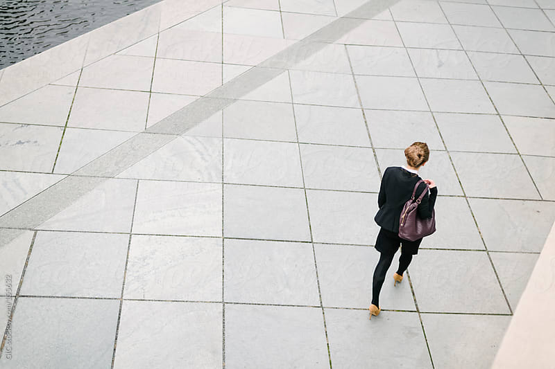 Businesswoman walking - overhead by GIC for Stocksy United