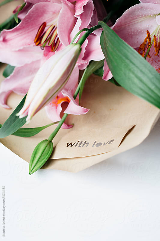 Bouquet in wrapping paper with a message by Beatrix Boros for Stocksy United