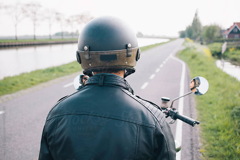 Motorcyclist looking at the road ahead, ready to ride by Ivo de Bruijn for Stocksy United