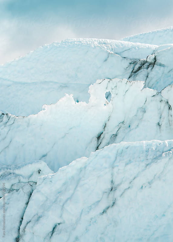 layers of glacial ice and snow by Tara Romasanta for Stocksy United