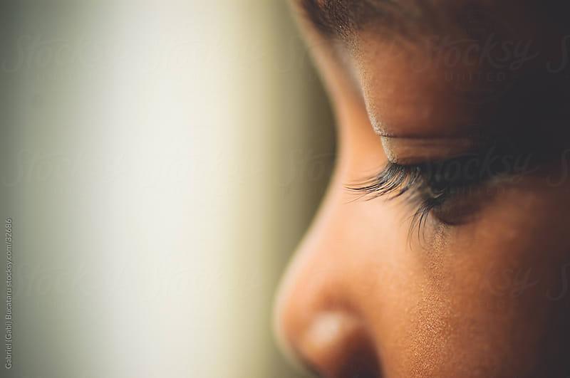 African American gir's eye closeup by Gabriel (Gabi) Bucataru for Stocksy United