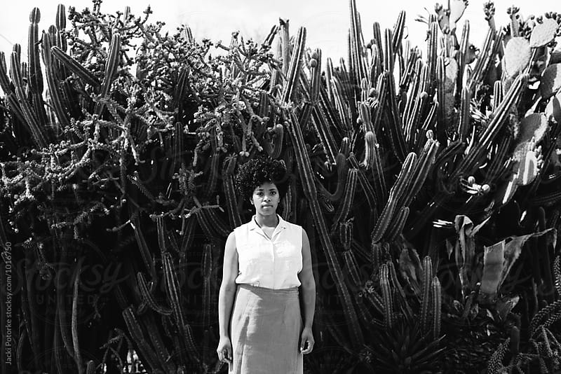 Young woman with cacti by Jacki Potorke for Stocksy United