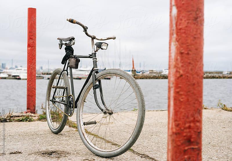 A retro men's bike on a pier by Tõnu Tunnel for Stocksy United