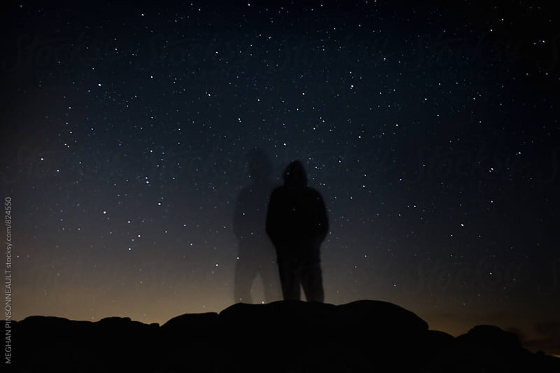 Double Silhouette of Man on Rocks at Night by MEGHAN PINSONNEAULT for Stocksy United