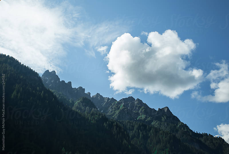 Cloud over the Dolomite Mountains by Maximilian Guy McNair MacEwan for Stocksy United