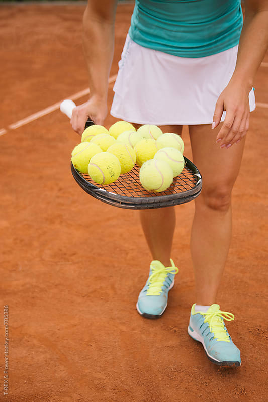 Closeup of tennis balls lying on the racquet by Danil Nevsky for Stocksy United
